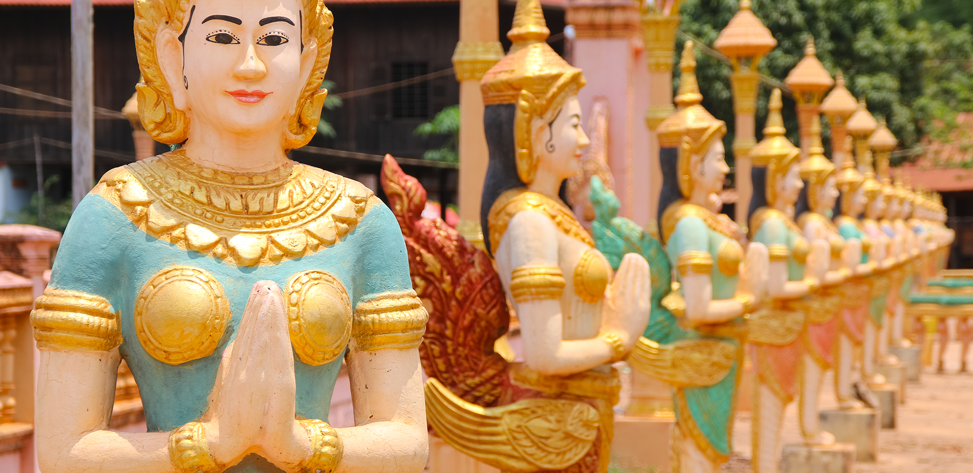 Temple Kinnara Chicken Lady Statues In A Row