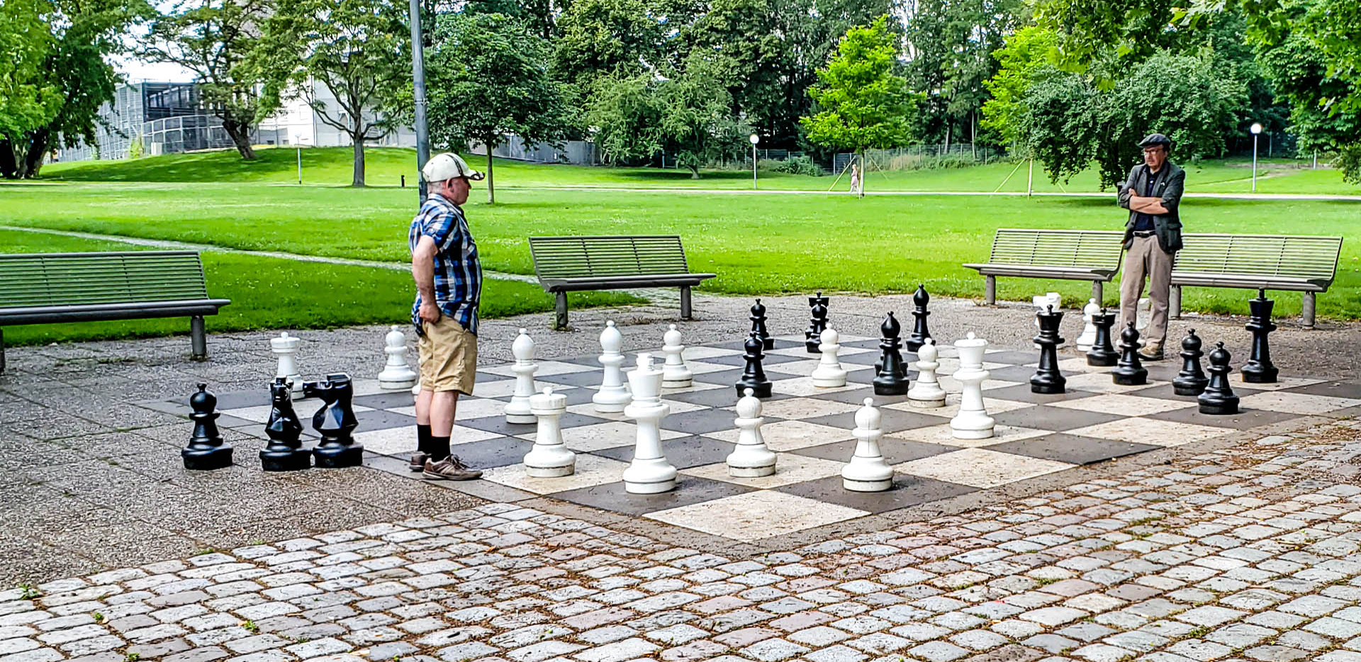 Men Playing Big Chess In Mittlerer Schlossgarten Park