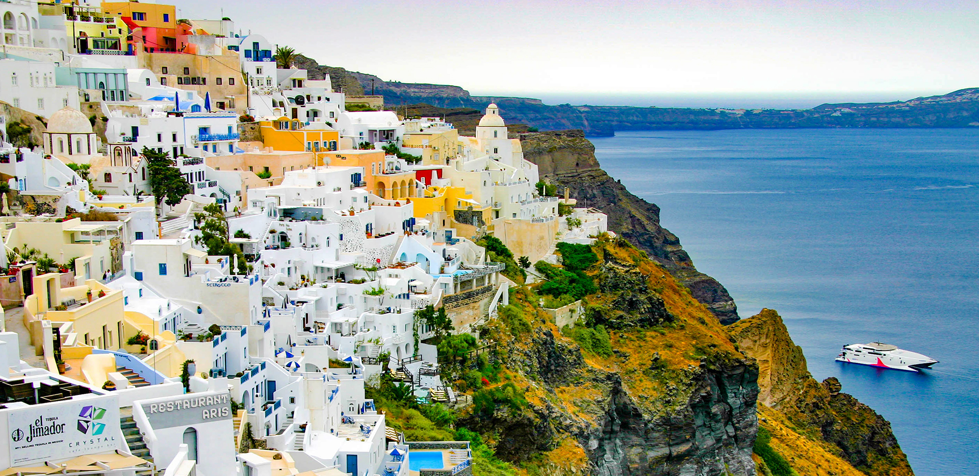 Fira White Buildings Overlooking Ocean and Boat