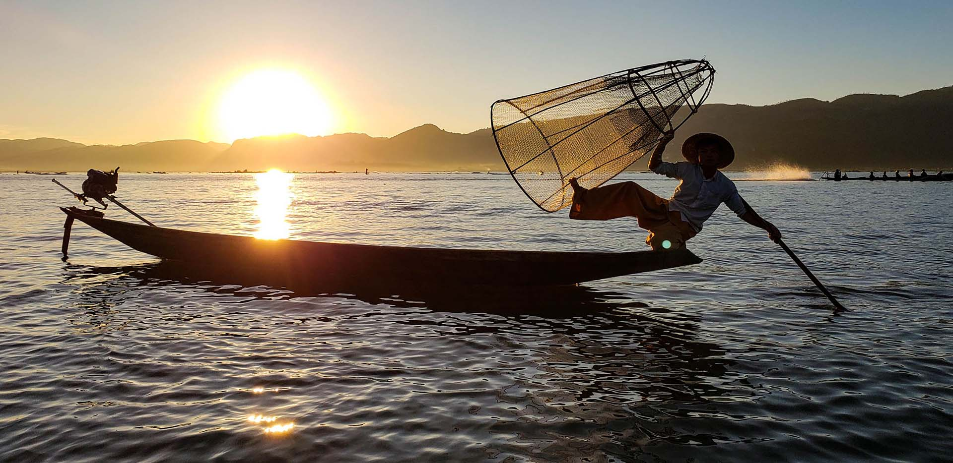 Leg Rowing Basket Fisherman at Sunset