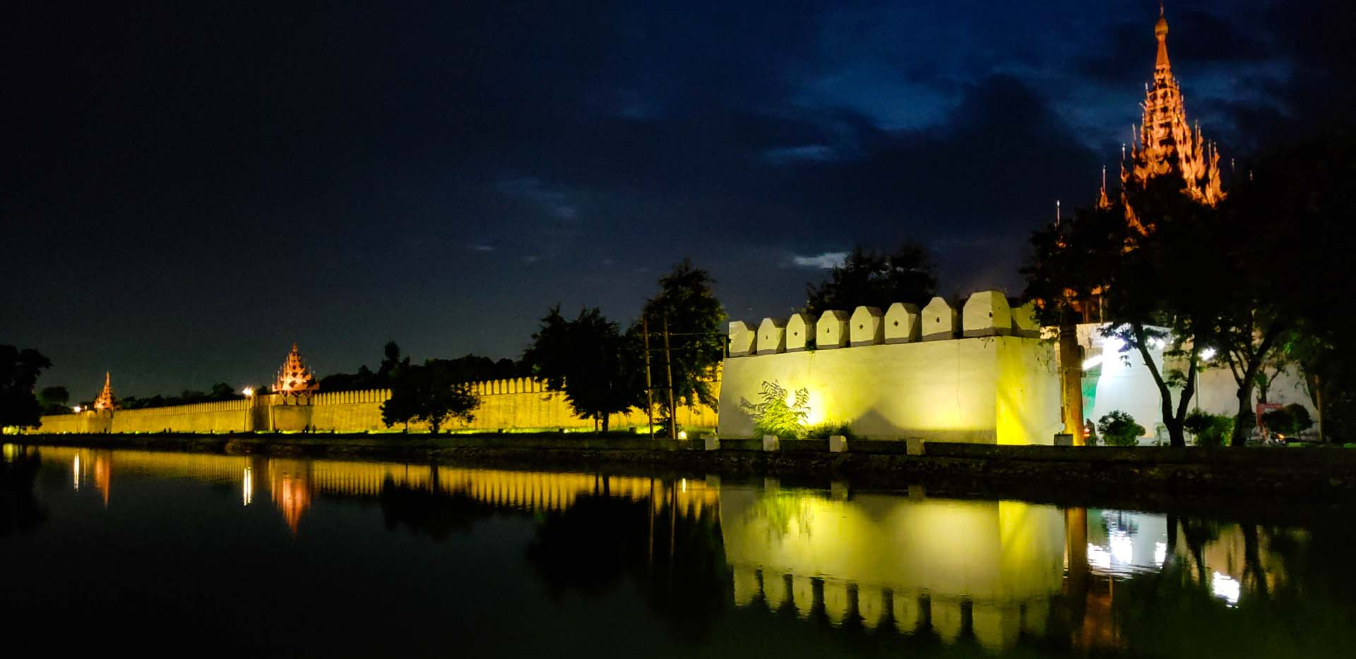 Palace Wall and Moat at Night with Lights