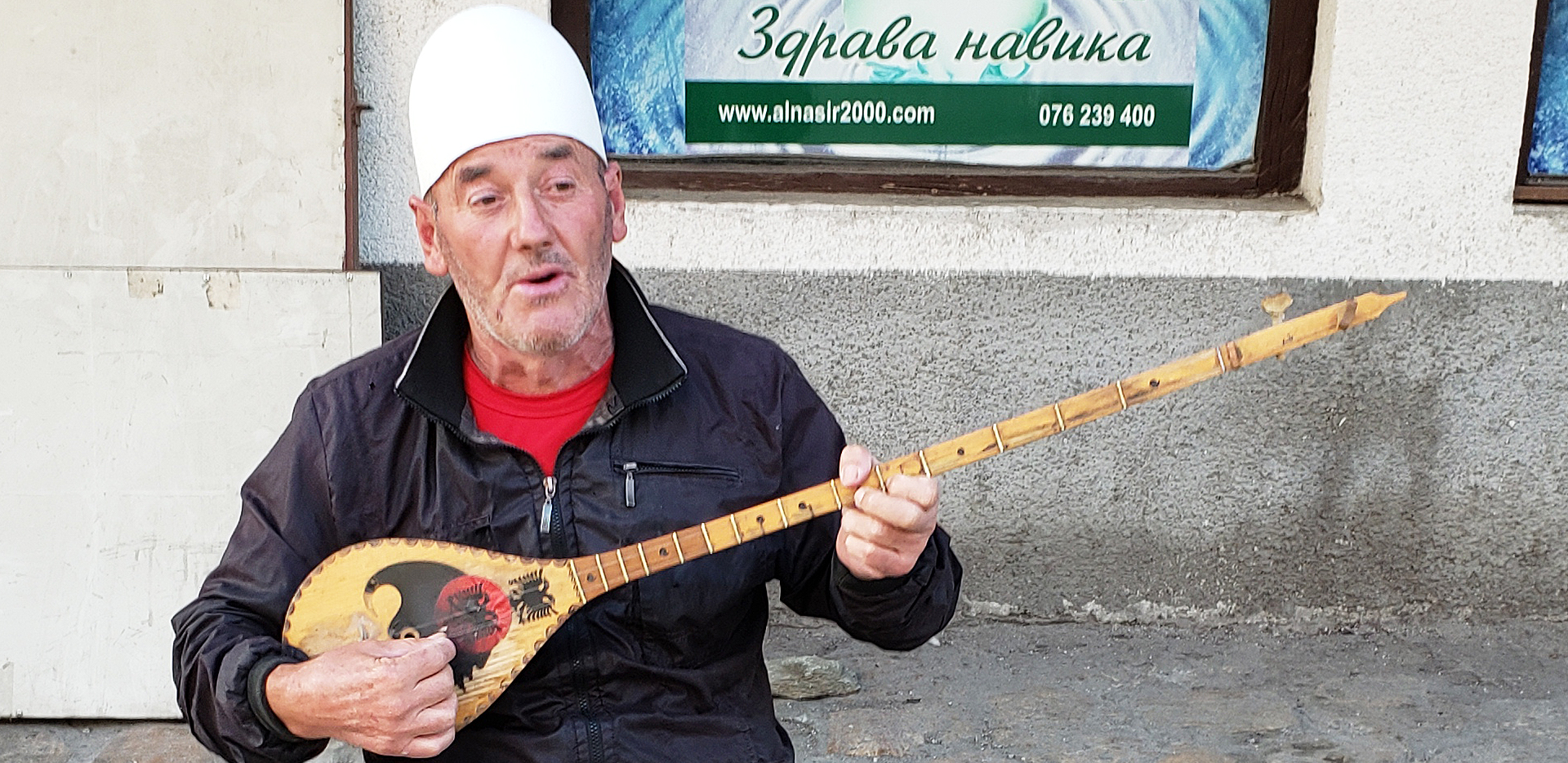 Street Musician Playing A Traditional Tambura