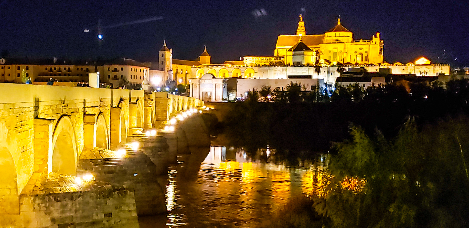Mosque Cathedral And Roman Bridge At Night